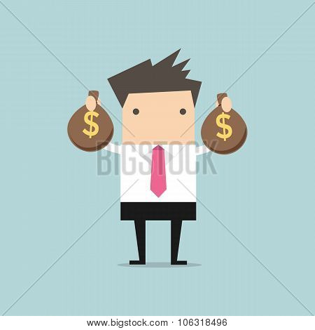 Businessman holding money bag in hands