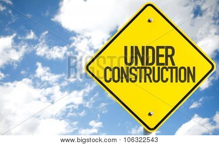 Under Construction sign with sky background