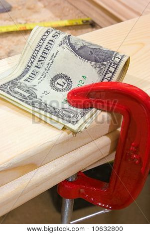 American dollar with clamp and wood plank