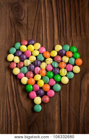 Colored Candy Drops In The Shape Of Heart
