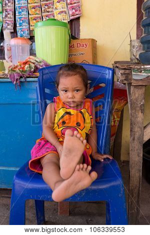 Indonesian Baby In Manado Shantytown