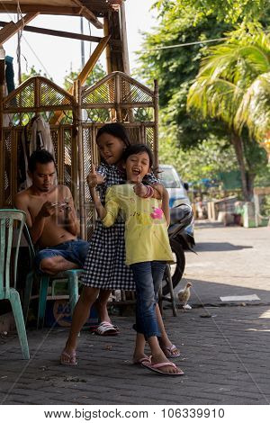 Indonesian Girls With Family In Manado Shantytown