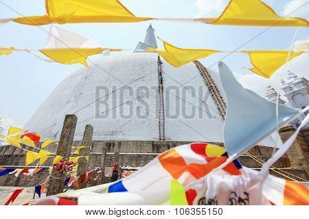 Anuradhapura dagoba with flags in  Ruvanvelisaya Sri Lanka