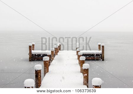 Empty Pier On A Cold Foggy Winter Morning