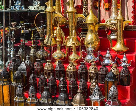 Row Of Shiny Traditional Coffee Pots And Lamp