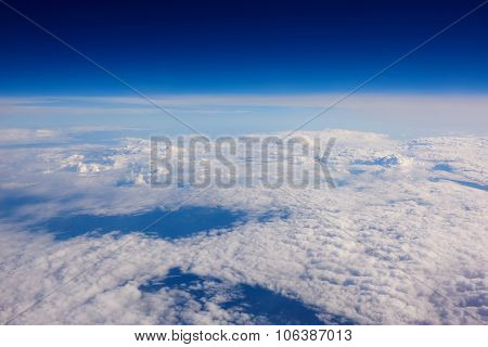 View from the airplane of a white clouds