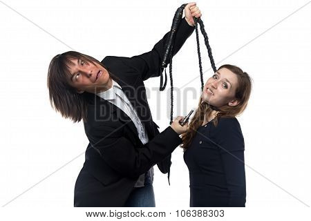 Crazy man in jacket holding woman with whip