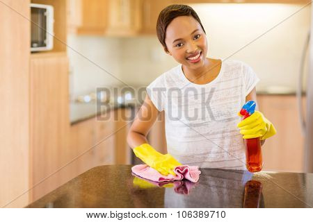 beautiful young african woman doing house chores