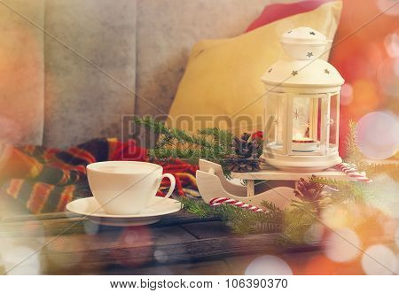 Still Life Interior Details, Cup Of Coffee, Candles And Christmas Decoration Near The Sofa