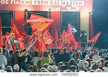Athens, Greece 10 October 2015. Fans of the left wing KKE waving their flags in Dimitris Koutsoubas
