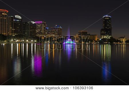 Orlando Lake Eola in the night and mirroring skyscrapoers