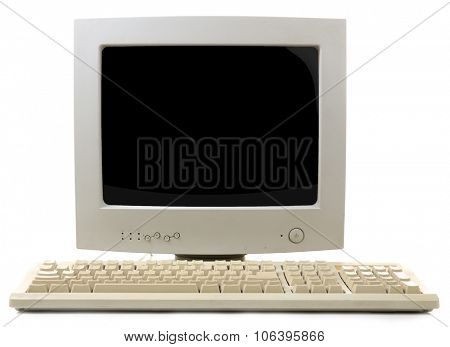 Old computer monitor and keyboard isolated on white