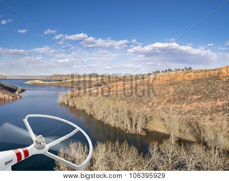 rotating drone propeller and aerial view of Horsetooth Reservoir near Fort Collins Colorado, in early spring with high water level