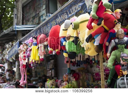 Colorful minions and superman puppets hanging for sale