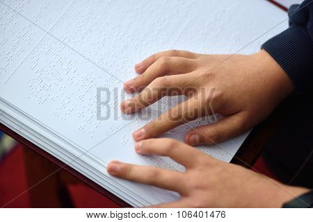 Blind Child Hand With A Disability Touch And Read The Cipher Code