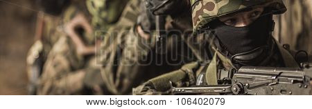 American marines with rifles waiting for enemy poster
