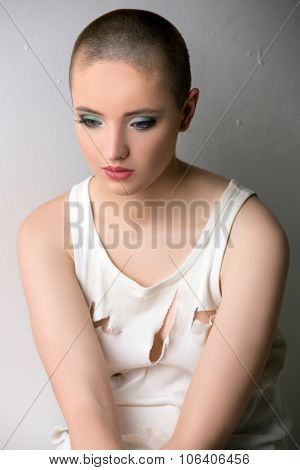 Image of beautiful skinhead girl in ragged t-shirt