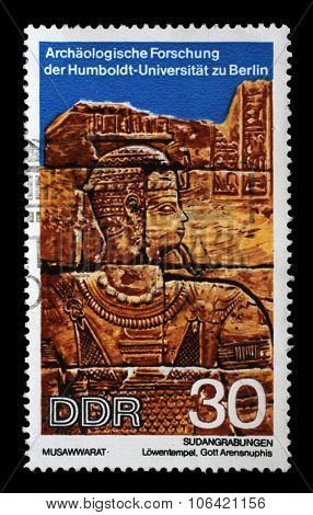 GDR - CIRCA 1970: A stamp printed in GDR shows Sudanese Archaeological Excavations by Humboldt University Expedition,God Arensnuphis,reproduce carvings unearthed at Lions Temple,Musawwarat, circa 1970