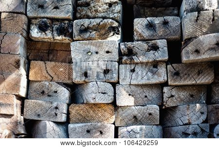 Stacked distressed 2x4 lumber viewed from end