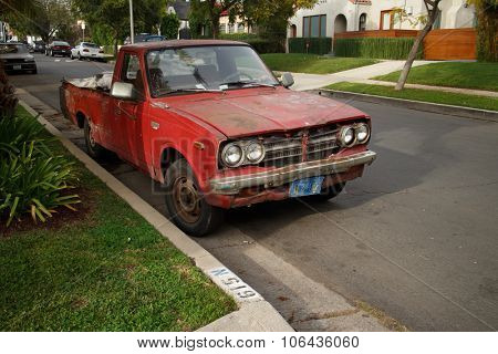 LOS ANGELES - March 10, 2015: Old beaten up pickup truck parked on a street of West Hollywood, CA