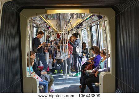 PARIS - SEPTEMBER 10, 2014: passengers in Paris Metropolitain train. The Paris Metro or Metropolitain is a rapid transit system in the Paris Metropolitan Area