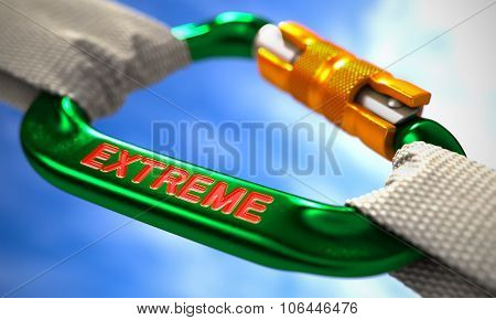 Extreme on Green Carabiner between White Ropes.