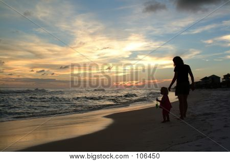 Mom And Daughter Walk On The Beach 2