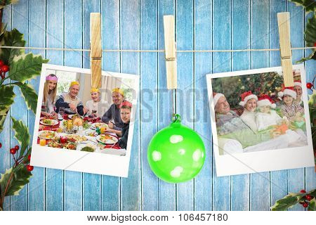 Hanging christmas photos against wooden planks