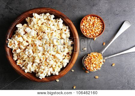Popcorn and corn beans on dark background