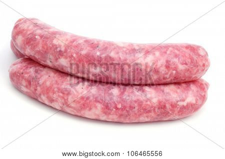 closeup of some uncooked pork meat sausages on a white background