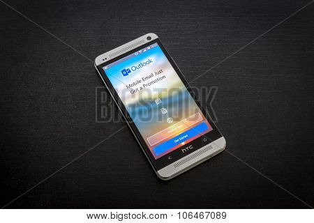 Microsoft Outlook email app on screen of a mobile smartphone.