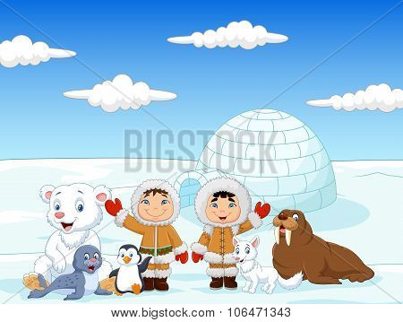 Little kids wearing traditional eskimo costume with arctic animals and igloo house background