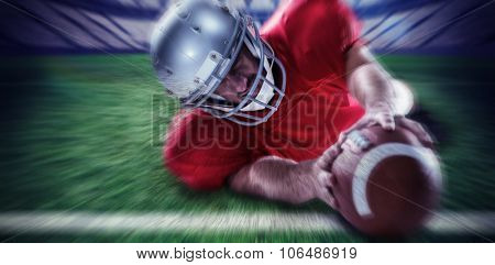 Sportsman struggling to catch the ball against rugby pitch