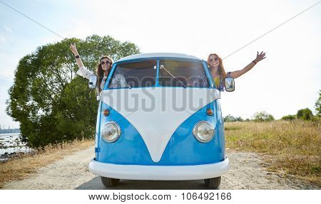 summer holidays, road trip, vacation, travel and people concept - smiling young hippie women driving minivan car and showing peace gesture poster