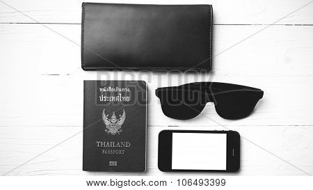 travel gadget over white table black and white color