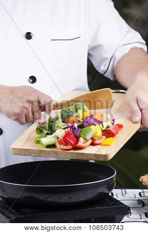 Chef Putting Vegetable To The Pan