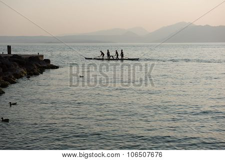 Four Rowers Rowing A Boat Standing