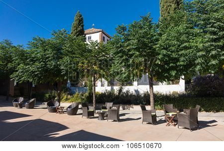 Warm Courtyard With Table And Chairs In Spain