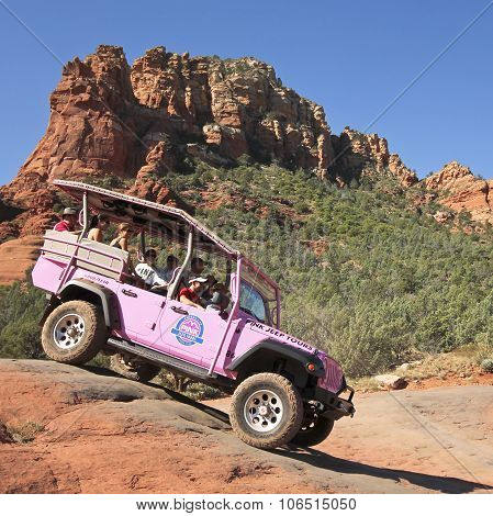 A Pink Jeep Tour Descends Broken Arrow Trail