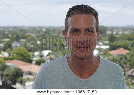 Man Smiling Directly At Viewer