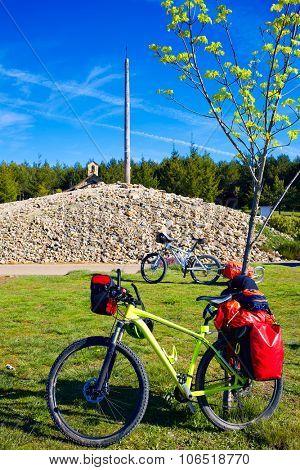 Cruz de Ferro top at Saint James Way bikes Leon Spain