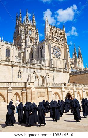 Burgos Cathedral facade in Saint James Way with unknown nuns at Castilla Leon of Spain