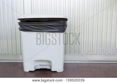 Black Bag Plastic In White Trashcan Bin