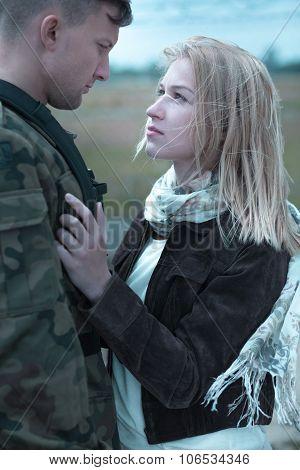 Young Couple Saying Goodbye