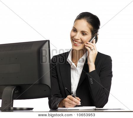 Young Businesswoman Working With Telephone And Computer