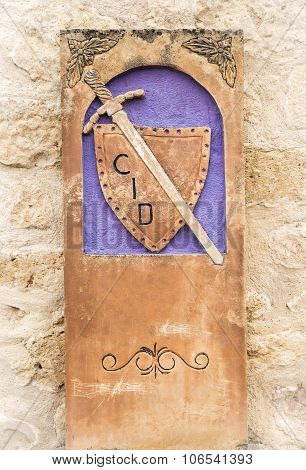 Camino del Cid signpost with a shield and a sword - Spain