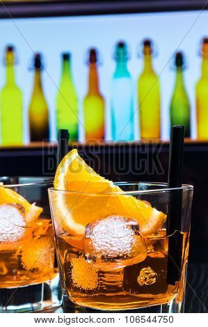 Detail Of Two Glasses Of Spritz Aperitif Aperol Cocktail With Orange Slices And Ice Cubes On Bar Tab