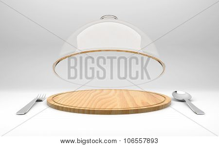 Open glass dome on wooden plate with spoon and fork