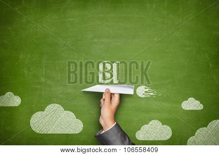 BI concept on blackboard with paper plane