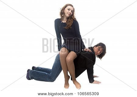 Woman sitting on man in black jacket